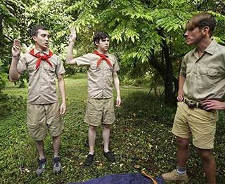 Scoutmaster Joshua Kelly tells boy scouts Dakota Lovell and Jack Andram that he's ready to teach them everything they need to know to earn their physical fitness merit badge.