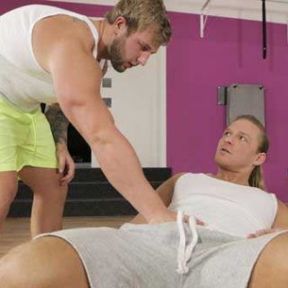 Blond muscle jocks Brick Morewood and Ondrej Oslava workout at the gym. Ondrej wants help with his crunches. Brick touches Ondrej's abs to make sure he's doing them right, then goes for his cock.
