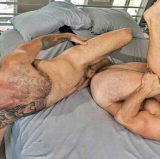 Bearded stud Jake Nicola is ecstatic to discover a completely naked Beau Butler waiting for him in bed. The hairy hunk quickly disrobes and immediately starts to rim Beau's furry ass.